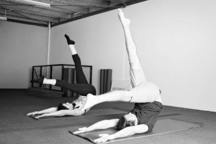 Male and female doing Pilates exercise, Control Balance