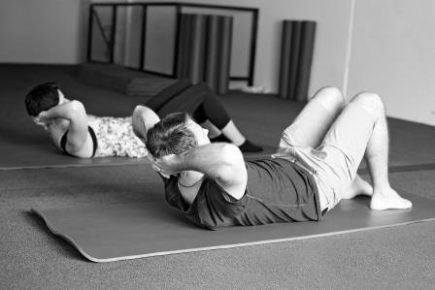 male and female doing Pilates sit up, could this help to reduce stress?