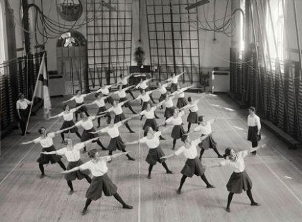 A group of women do a Swedish Gymnastics class at the Royal Central Institute of Gymnastics