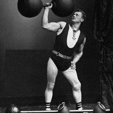 Eugen Sandow one of the Strongman Physical Culturists posing with a dumbbell