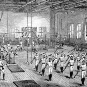 Turnen men expressing their Physical Culture by doing gymnastics and swinging clubs in a Turnverein gymnasium