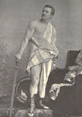 Am image of Eugen Sandow muscle posing with a sword in ancient Roman clothing.