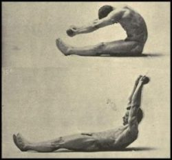 Eugen Sandow performing an abdominal exercise holding light dummbells.